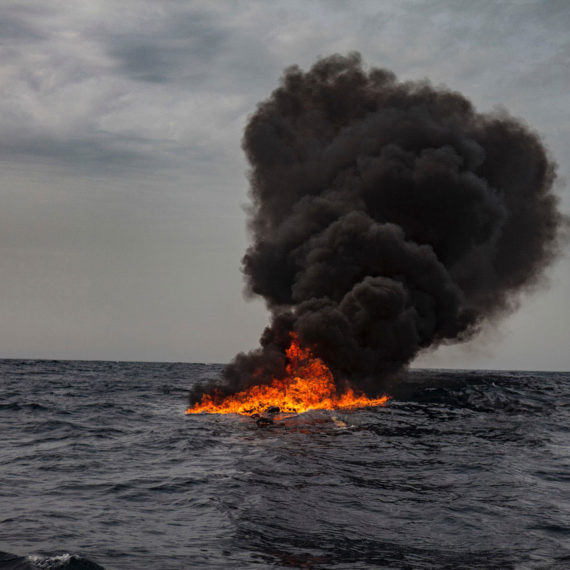 Fire Water - ©Jason Florio. Color - burning smugglers boat in the Mediterranean Sea