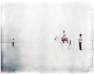 Buy beautiful prints - Oskar Landi #3- ALSO IN INDIA. Color. Polaroid. 3 Indian men, one on a horse, against a stark white background