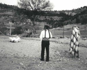 KWIRA (Tarahumara) #150 ©Oskar Landi . Black & white - two men walking in cemetary