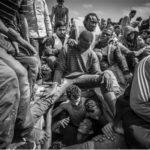Magnum Photography Awards 2017. Image © Jason Florio - Photojournalism Winner,- migrants coming from below deck on packed smugglers boat