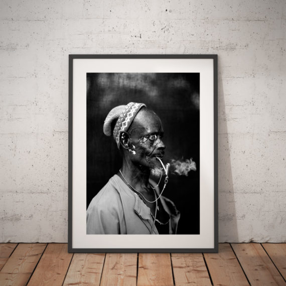 Black and white print of an old man smoking his pipe, Gambia, W Africa 'SILVER PIPE MAN' © Jason Florio