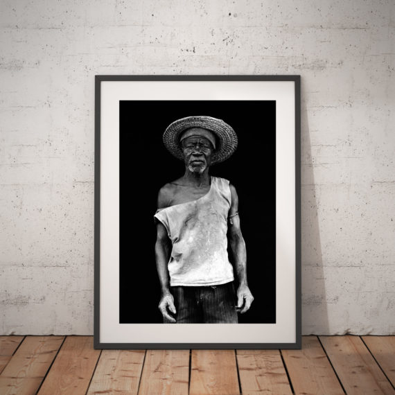 Black and white portrait of black man in straw hat, Gambia, W Africa 'THE FARMER' © Jason Florio
