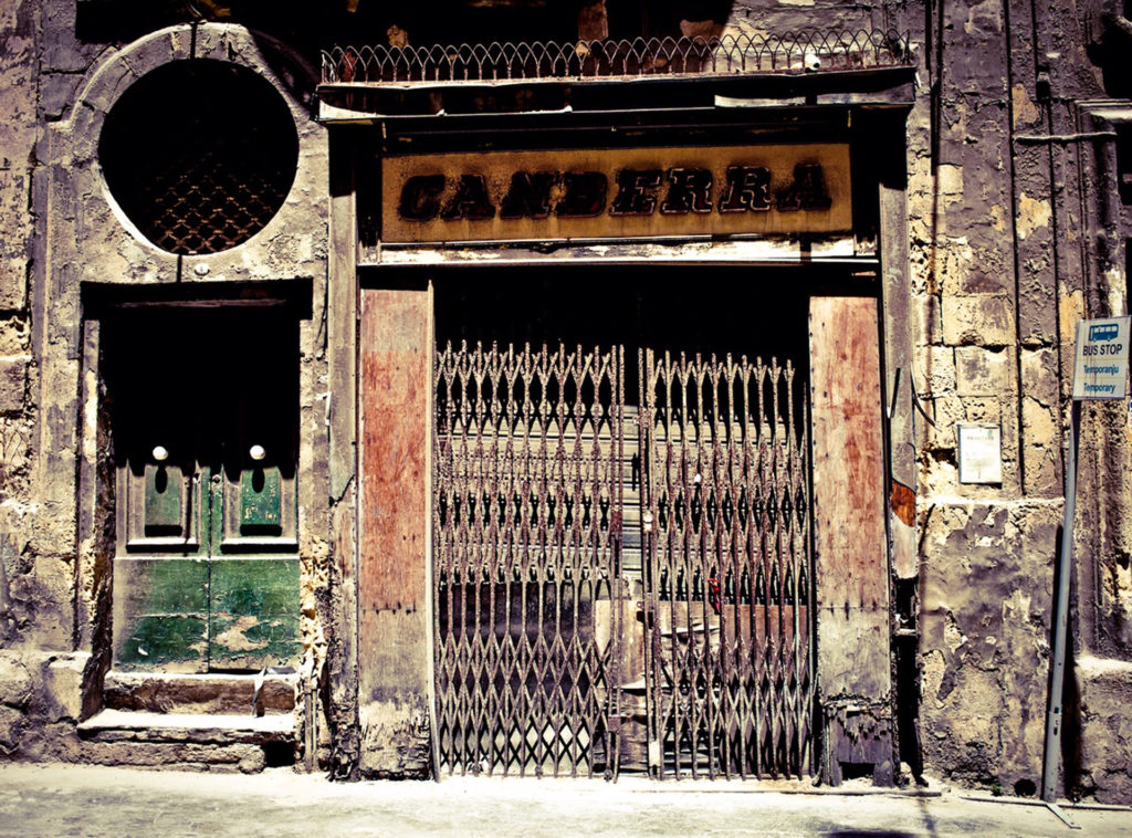 Disappearing Malta - doors, and facades ©Helen Jones-Florio. 'Canberra' storefront, Valletta