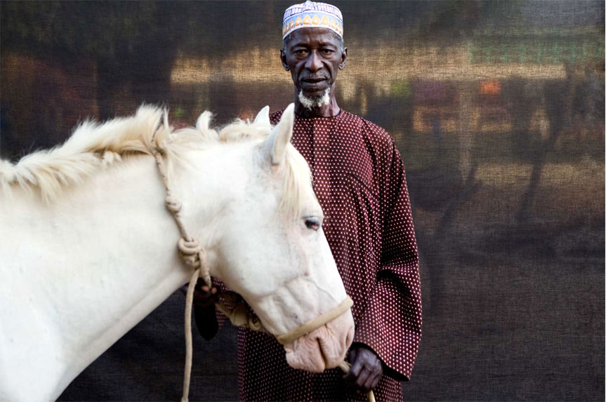 Alkalo Herouna Tonkara pose with his white horse ©Jason Florio 'Silafando' The Gambia, West Africa