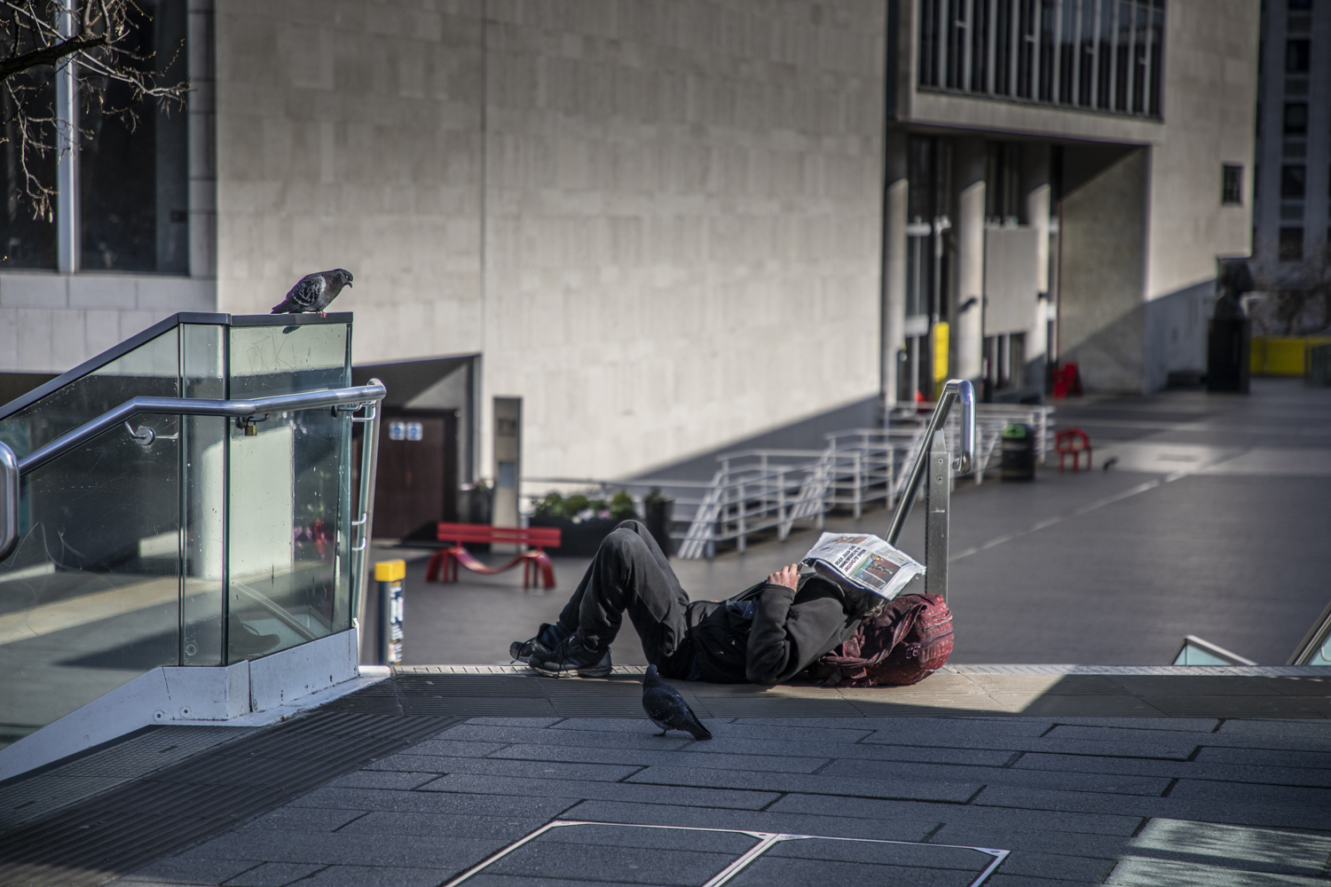 COVID 19 London lockdown. Homelessness - a homeless man lies sleelping on the floor at the Southbank. Image ©Jason Florio