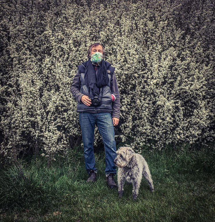In isolation between a 'Rock and a Hot Place' - photojournalist Jason Florio, standing with his mum's dog, 'Space'. Image ©Helen Jones-Florio, April 2020