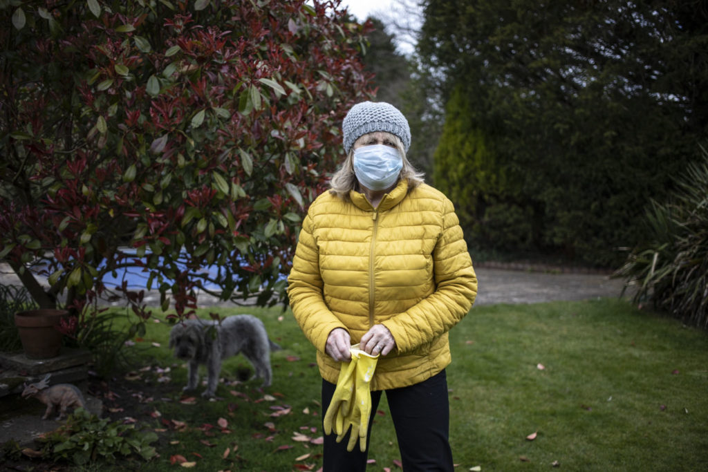 In isolation between a 'Rock and a Hot Place' - Jason's Mum, who is self-isolating, wearing a mask outside and keeping her social distance (her dog. Space, is in the background) ©Jason Florio April 2020