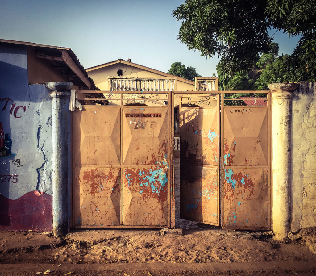Gambia Doors - 'Gates to the compound of the family of the late Omar Barrow, Red Cross volunteer and journalist, one 16 young people killed by security forces in April 2000 The Gambia, West Africa. Image ©Helen Jones-Florio