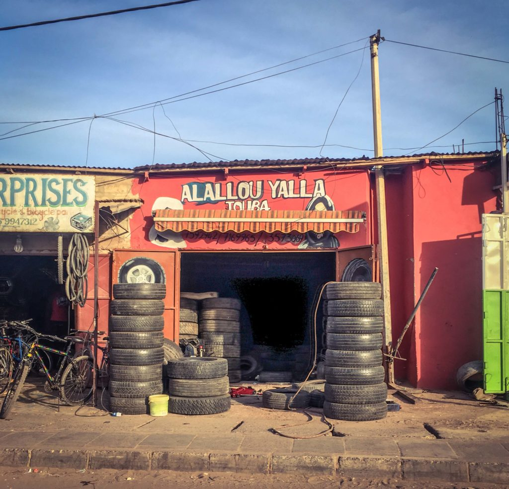 Gambia Doors - car tire shop, The Gambia, West Africa. Image ©Helen Jones-Florio storefronts