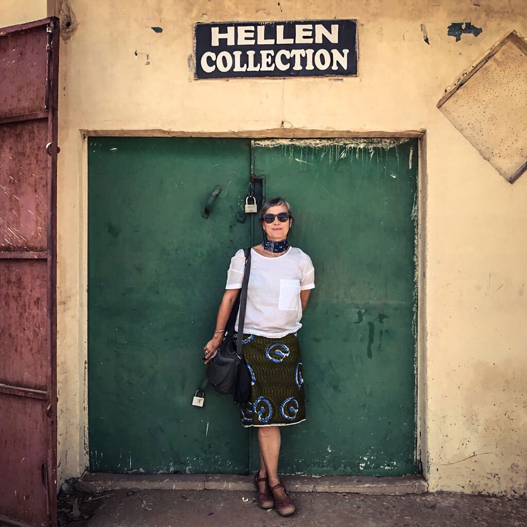 Photographer, Helen Jones-Florio standing in front of a door in The Gambia, West Africa. Image © Jason Florio