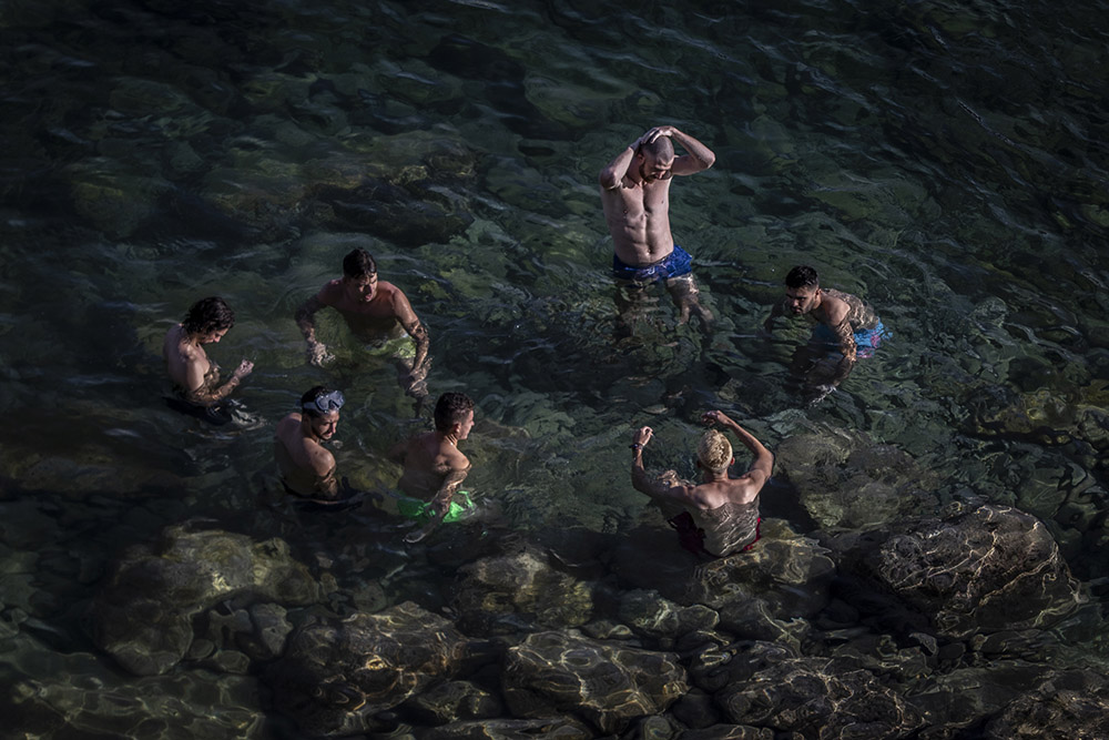 Stelle del Mare Images ©Jason Florio a small group of men bathing in the Mediterranean Sea, Malta