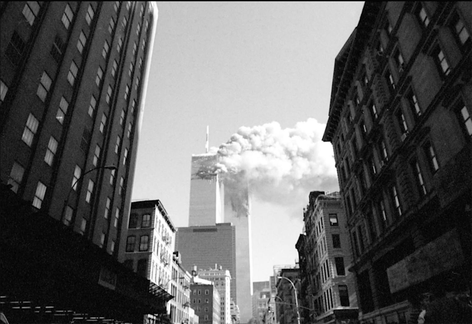 'The Day The Towers Fell - my 9/11 journey' Jason Florio: September 11th, 2001-the North Tower on fire after the first plane hits, World Trade Center Towers, NYC. Black and white image ©Jason Florio