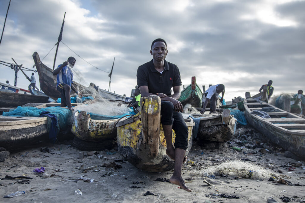 Isaac Mensah, James Town beach, Accra, Ghana © Jason Florio. Isaac is the son of one of 44 murdered Ghanian migrants, by Gambian security forces, in The Gambia, in 2005.